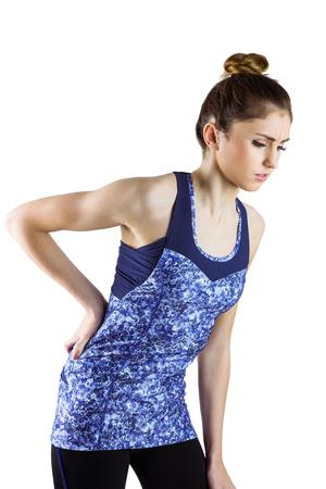 dolor  muscular: Morena Fit con lesi�n en la espalda en el fondo blanco