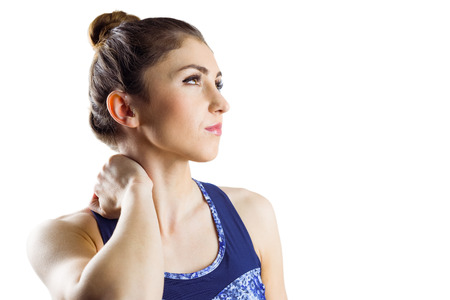 Fit brunette with neck injury on white background photo