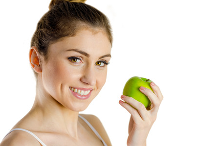 body concern: Slim woman holding green apple on white background Stock Photo