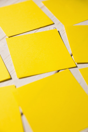 its: Yellow post its on wooden backround