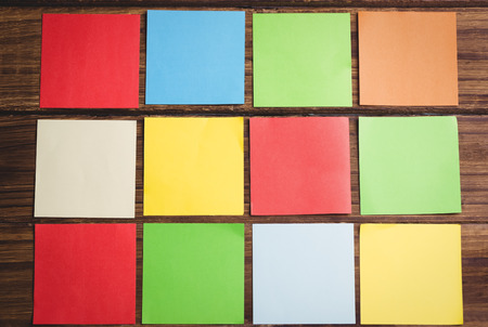 its: Colorful sticky post its on wooden background