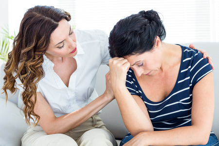 comforting: Therapist comforting her patient on white background