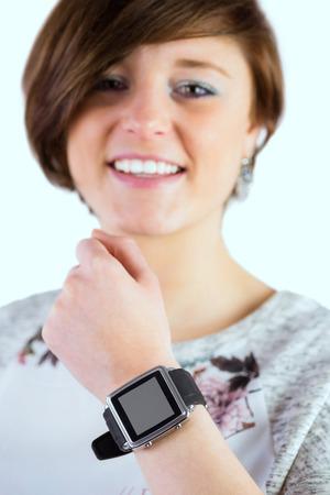 cut wrist: Pretty brunette wearing her smartwatch on white background