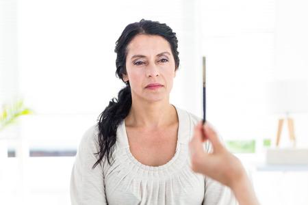Woman being hypnotized on white background Zdjęcie Seryjne