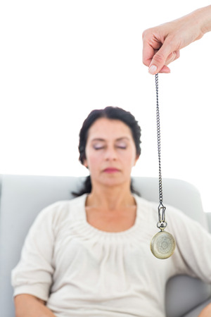 hypnotherapy: Woman being hypnotized on white background Stock Photo