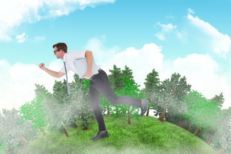 running late: Geeky businessman running late against blue sky Stock Photo