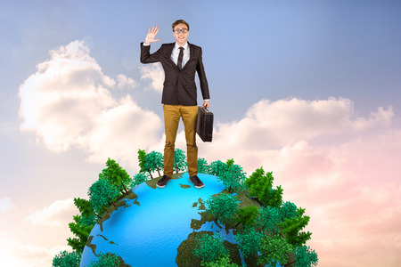 businessman carrying a globe: Young geeky businessman holding briefcase against beautiful blue cloudy sky Stock Photo