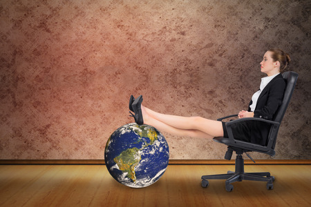 grimy: Businesswoman sitting on swivel chair with feet up against grimy room