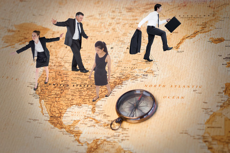 balancing act: Businesswoman performing a balancing act against world map with compass showing north america
