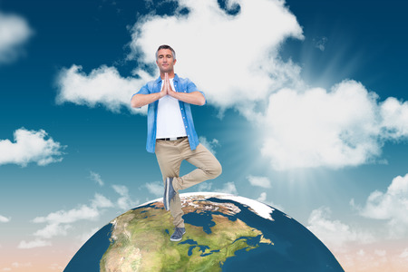 grey hair: Man with grey hair in tree pose against blue sky Stock Photo
