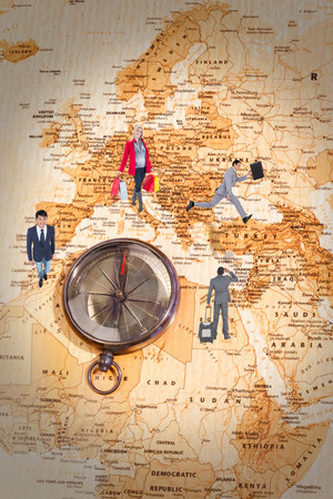 businessman carrying a globe: Happy blonde in winter clothes holding shopping bags against world map with compass showing north africa and europe Stock Photo
