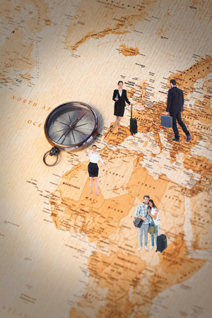 businessman carrying a globe: Businessman walking while holding briefcase  against world map with compass showing africa and europe