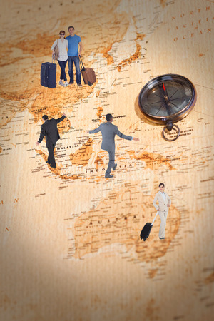 balancing act: Mature businessman doing a balancing act against world map with compass showing oceania and the far east