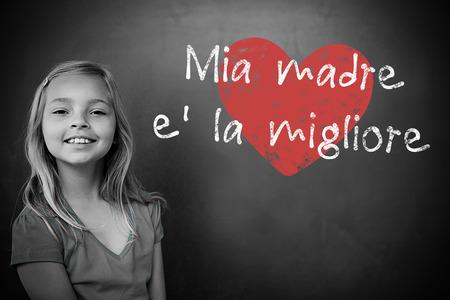 schoolchild: Italian mothers day message against schoolchild with blackboard Stock Photo