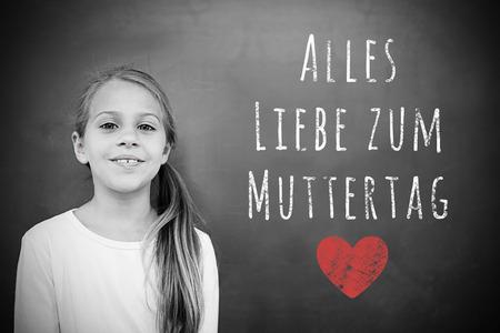 schoolchild: Schoolchild with blackboard against german mothers day message