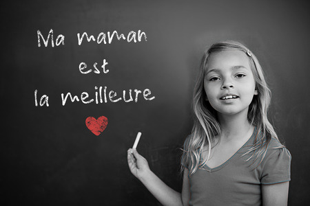 schoolchild: French mothers day message against schoolchild with blackboard