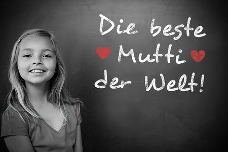 schoolchild: German mothers day message against schoolchild with blackboard