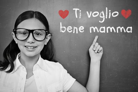 schoolchild: Schoolchild with blackboard against italian mothers day message Stock Photo
