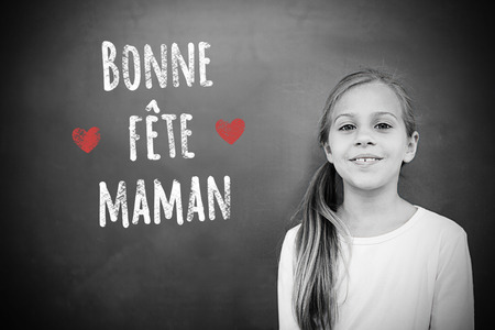 schoolchild: Schoolchild with blackboard against french mothers day message Stock Photo