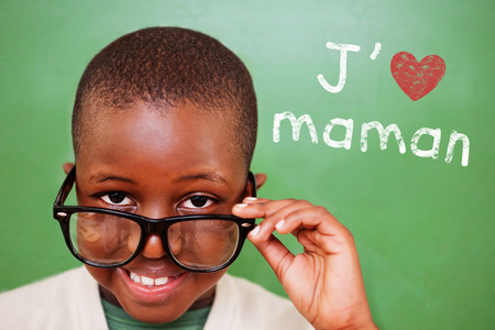 pupil: Cute pupil tilting glasses against green