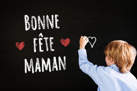 pupil: Cute pupil writing against black