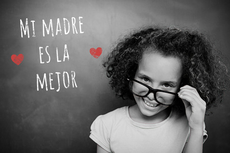 schoolchild: Schoolchild with blackboard against spanish mothers day message