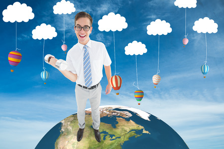 lifting globe: Geeky happy businessman lifting dumbbell against hot air balloons hanging from clouds
