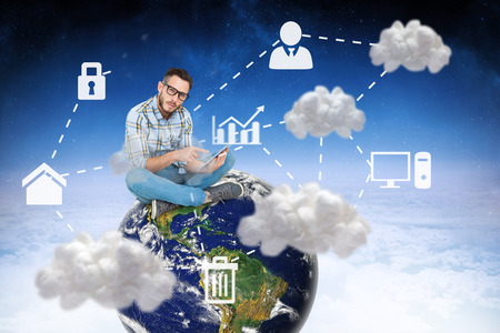 using tablet: Handsome hipster using tablet pc against cloud computing graphic with icons