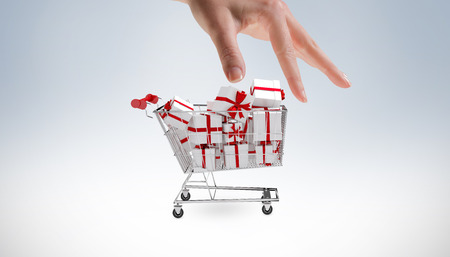 gift spending: Hand showing against white background with vignette