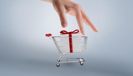 gift spending: Hand showing against grey vignette