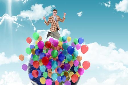 geeky: Geeky hipster looking nervous against blue sky