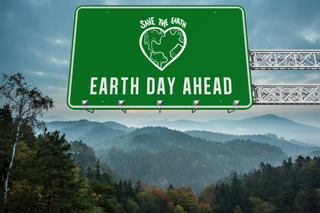 escapism: earth day ahead against trees and mountain range against cloudy sky