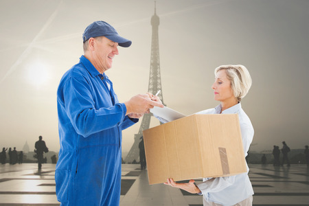 boiler suit: Happy delivery man with customer against eiffel tower Stock Photo