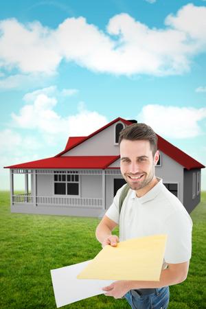 envelop: Happy derivery man giving envelop against blue sky