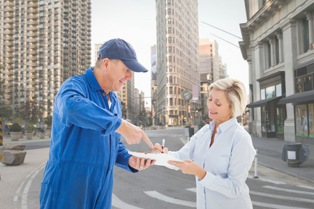 boiler suit: Happy delivery man with customer against new york street