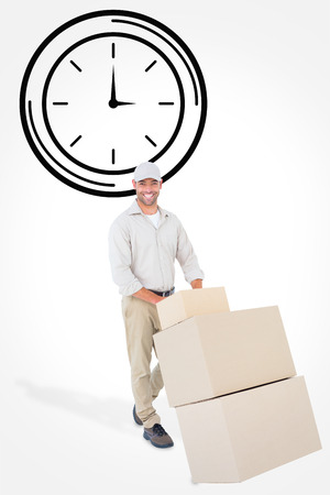 against the clock: Happy delivery man pushing trolley of boxes against clock
