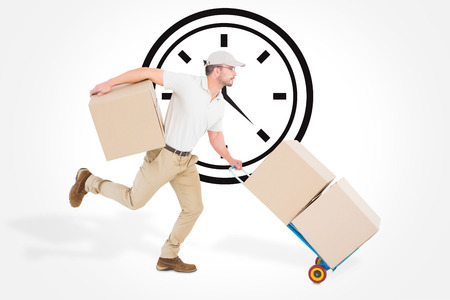 against the clock: Delivery man with trolley of boxes running against clock Stock Photo