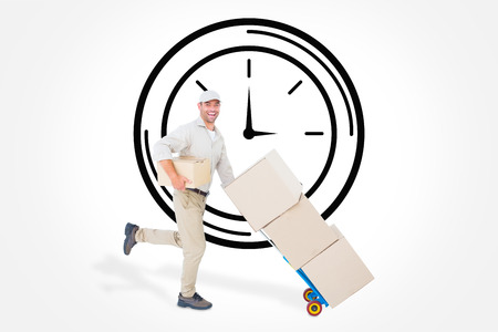 against the clock: Happy delivery man with trolley of boxes running on white background against clock