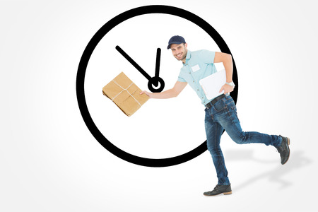 against the clock: Happy delivery man running with package against clock