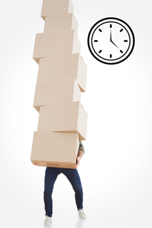 against the clock: Man carrying pile of boxes against clock