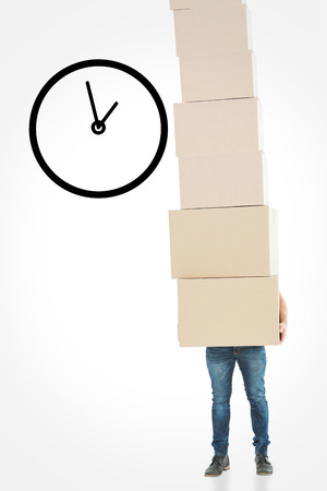 against the clock: Courier man carrying cardboard boxes against clock