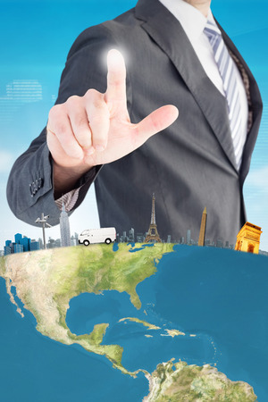Businessman pointing with his finger against shiny cityscape on black background photo