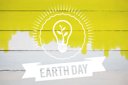 yellow earth: Earth Day Graphic against yellow paint on fence