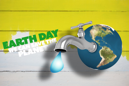 yellow earth: Earth with faucet against yellow paint on fence