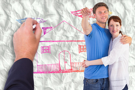 Couple holding keys to home against crumpled white page photo