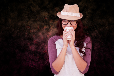 disposable cup: Brunette with disposable cup against dark background Stock Photo