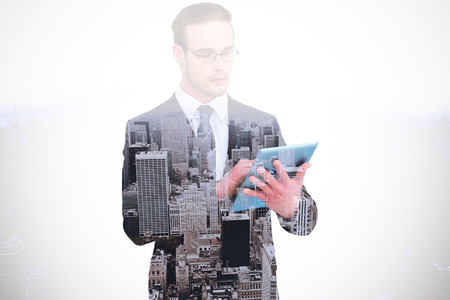 unsmiling: Unsmiling businessman using tablet pc against high angle view of city