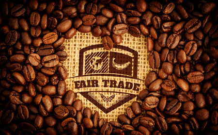 indent: Fair Trade graphic against heart indent in coffee beans