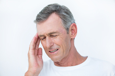 headache man: Patient with headache in medical office