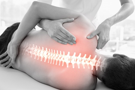 female therapist: Digital composite of Highlighted spine of man at physiotherapy